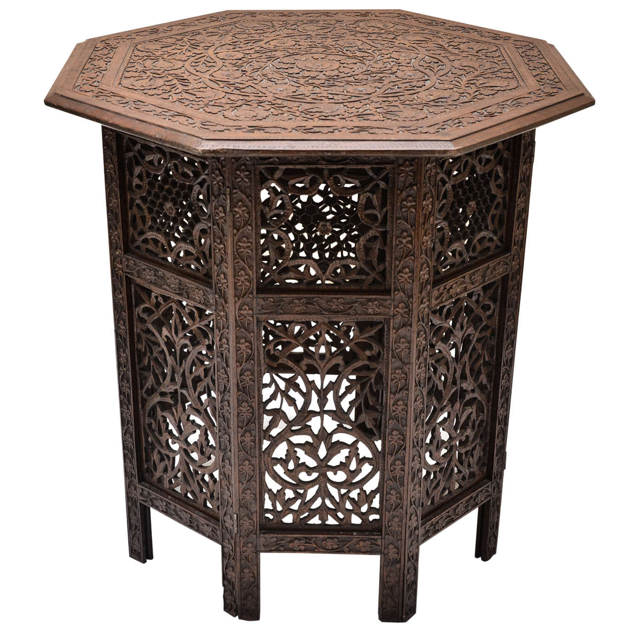 Indian mogul influenced carved teak occasional table at for Indian carved coffee table