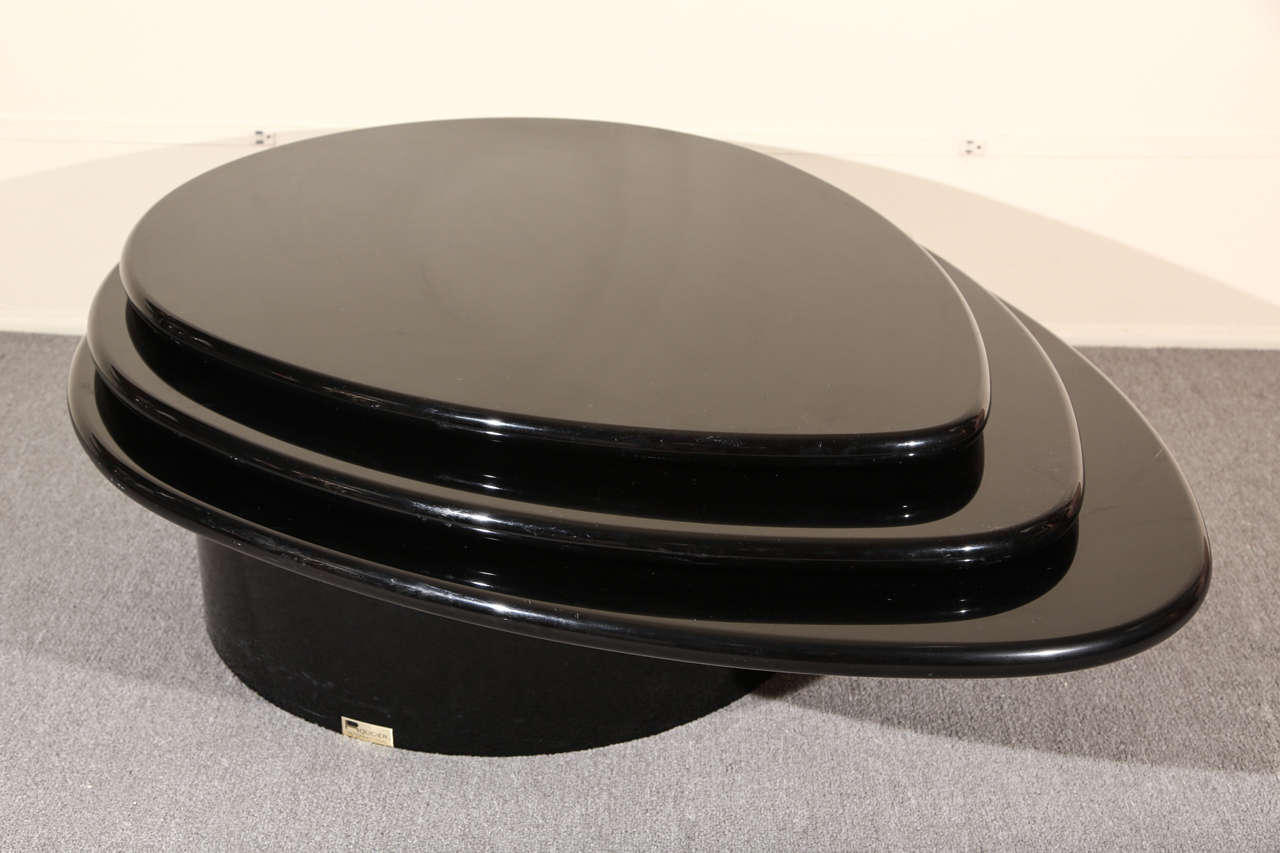 Wonderful three tiered level Black lacquered coffee table by Rougier. The table retains its original black lacquer finish which is in very good condition with minimal scratched due to age.