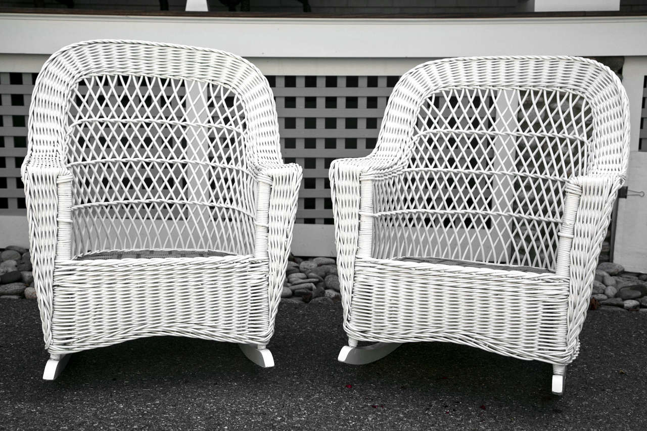 Matching Bar Harbor Wicker Rockers which coordinate with a sofa and settee listed separately.  Full skirt on all sides.
