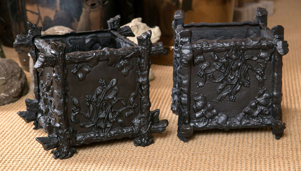 A pair of lovely French black painted cast iron planter boxes with a twig and foliage design.
