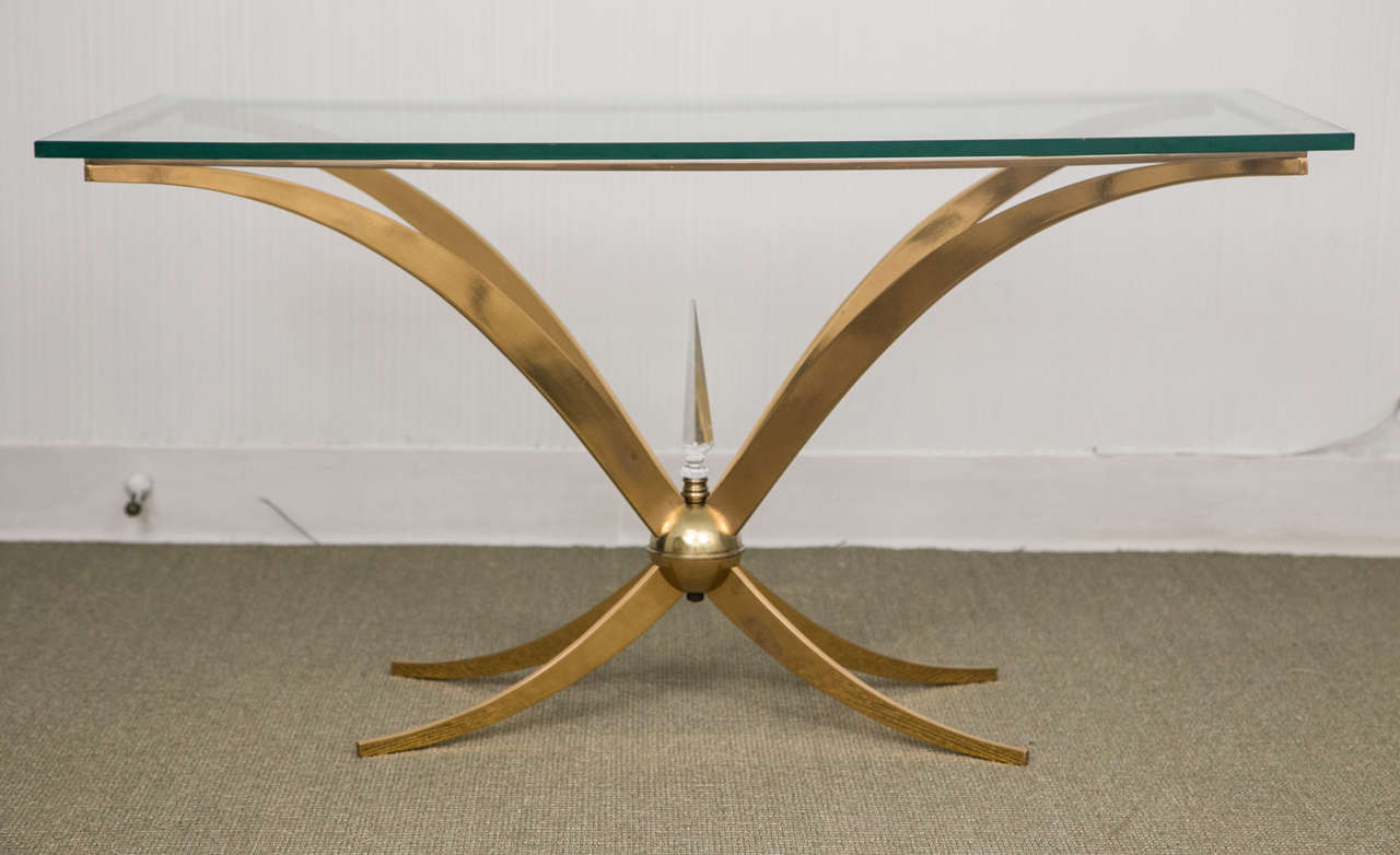 Unusual Italian gold-plated brass coffee table with crystal finial and glass top.
