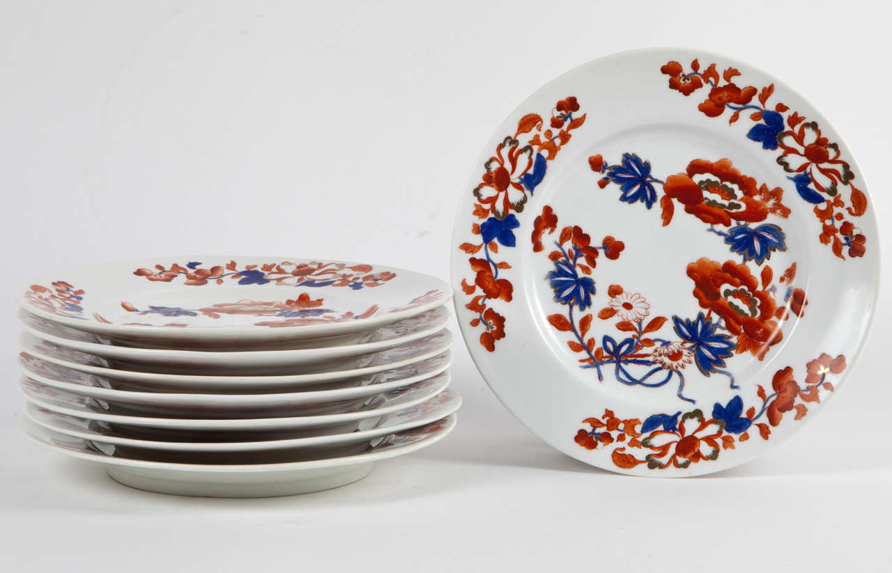 A set of eight Chamberlin's Worcester boldly-colored porcelain dessert or salad plates in the Japan Imari pattern #982. England, 1820. Signed with hand applied mark.   A rare and fine example of English porcelain, this hand painted piece features
