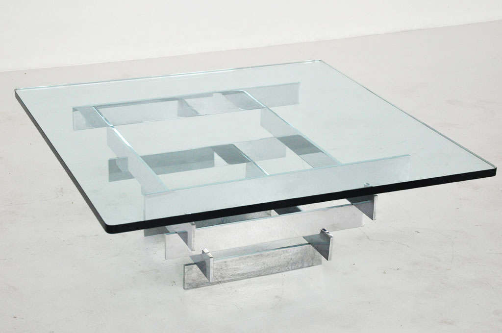 Chrome base coffee table by Paul Mayan for Habitat.  Solid chrome flat bar in pyramid shape with thick plate glass top.