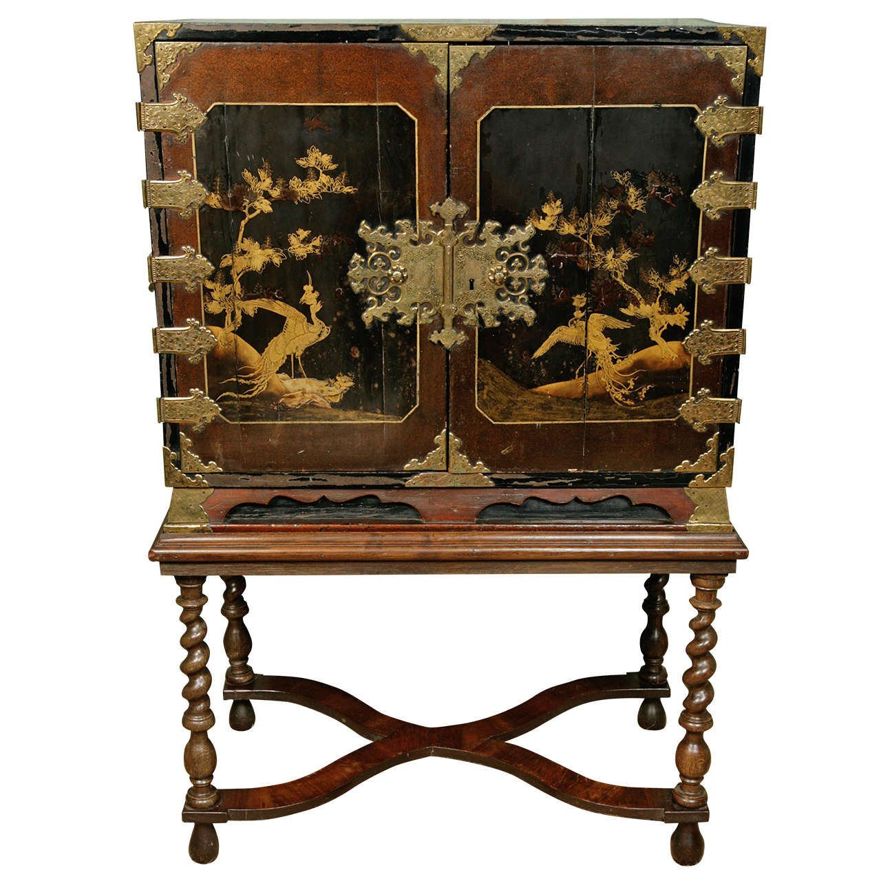 A 17th Century Japanese Lacquer Cabinet On English Stand