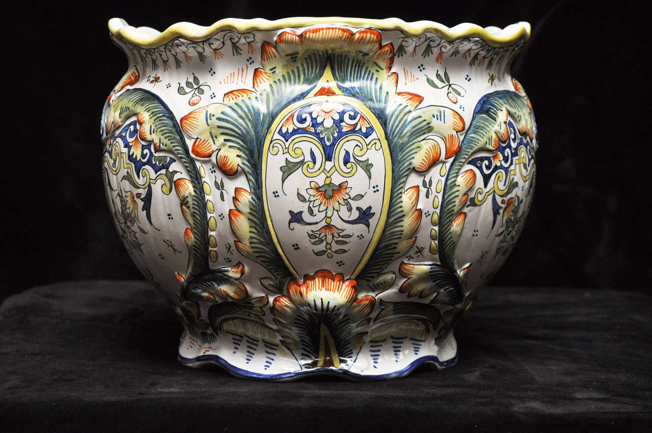 A brilliant pair of fine, French polychrome faience Jardinieres beautifully hand-painted in the style made famous by the skilled artisans of Rouen, France. Fluted at rim and base.