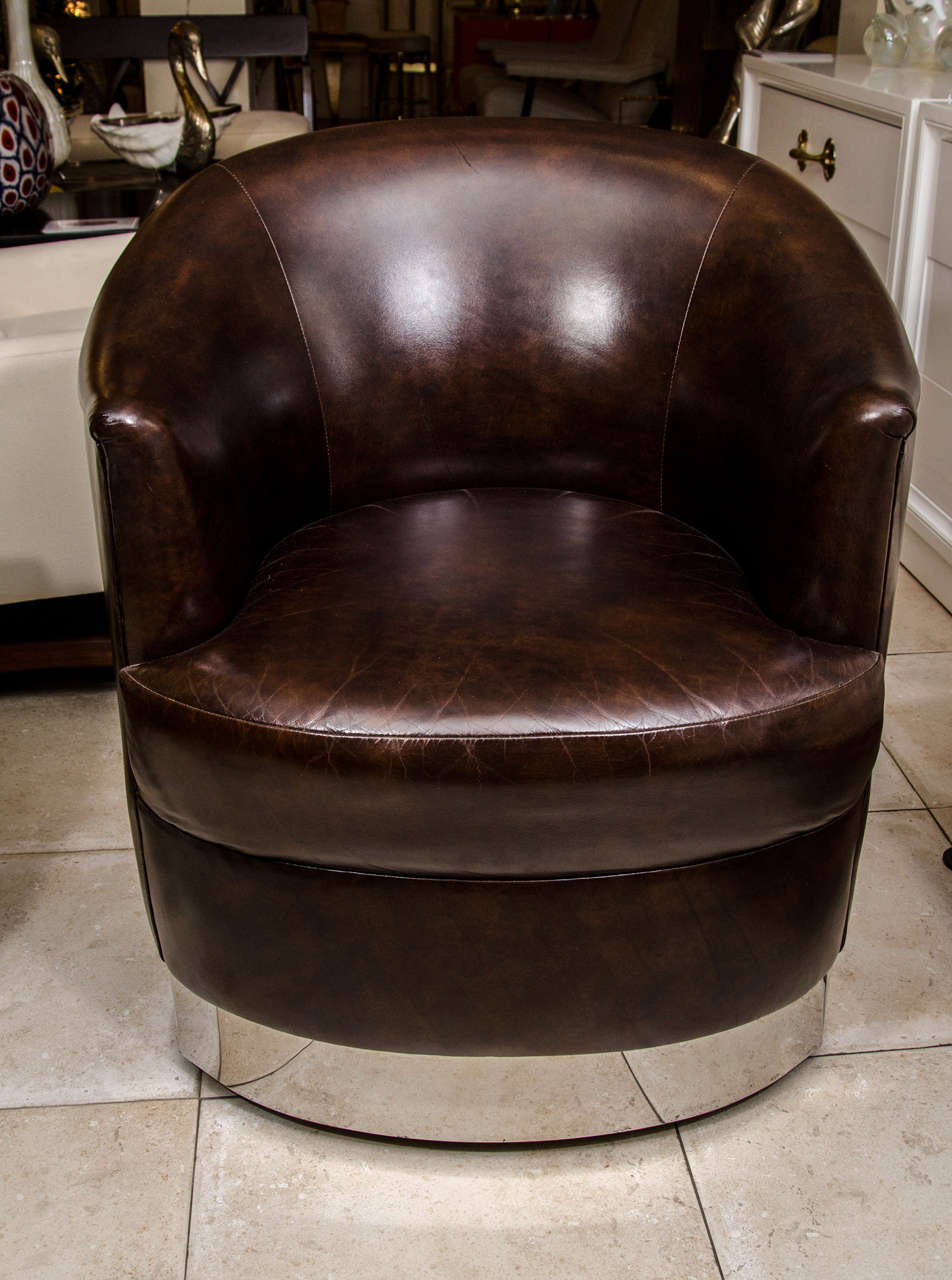 Pair Of Barrel Back Leather Upholstered Swiveling Club