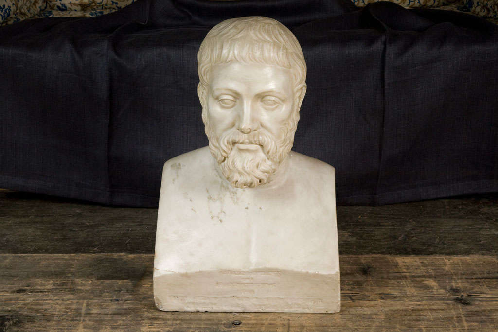 An early 19th century continental carved marble bust of a scholar. The bearded gentleman gazing forward, traces of old inscription to base.