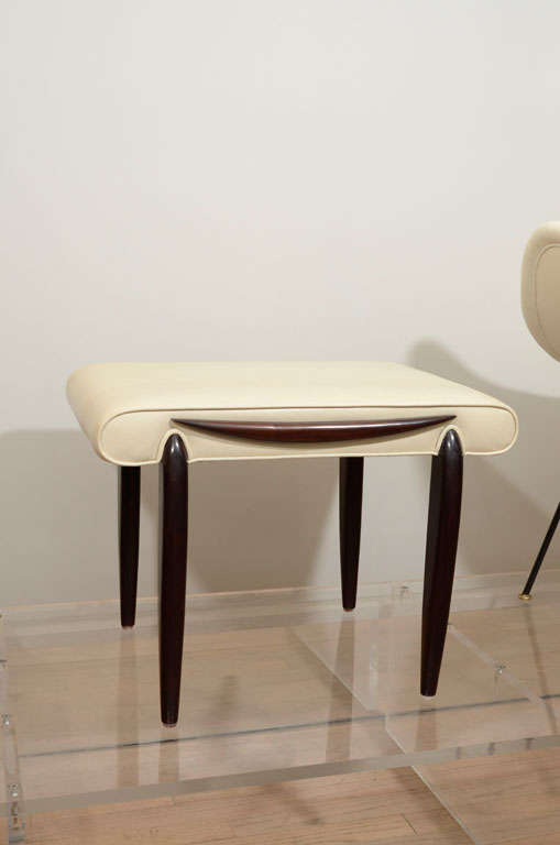 Leather upholstered stool.