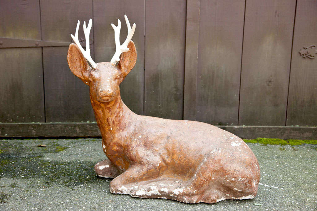 Adorable cast iron deer painted brown with white antlers