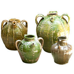 Set of Four Glazed Artisan Crafted Jars