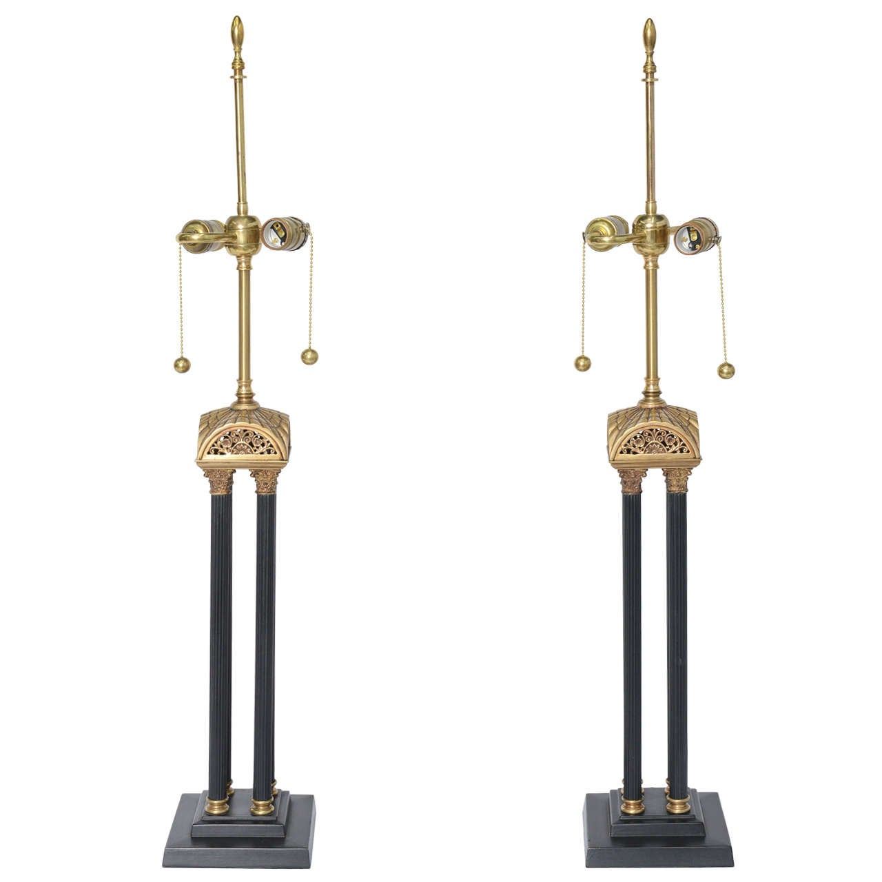 REDUCED FROM $3,200. Exquisite craftsmanship describes this pair of English neoclassical style table lamps with four Corinthian columns rising from a stepped plinth base to a stylized arched roof with reticulated and pierced scroll work. The stem