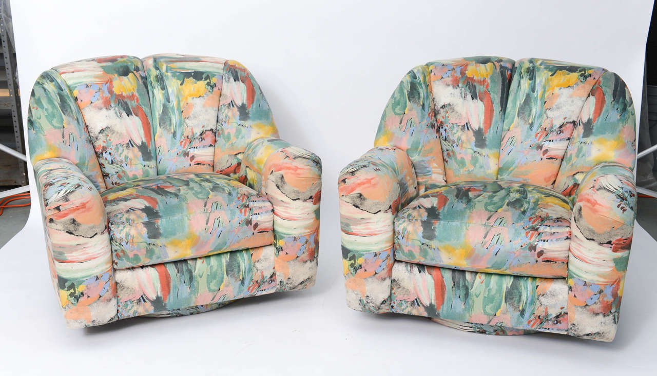 ....SOLD....In original Impressionist splash of color silk upholstery, this exceptional pair of Directional Lounge Chairs on swivel bases has it all. Large scale comfort, smooth curved outer body and overstuffed channeled front. Glorious original