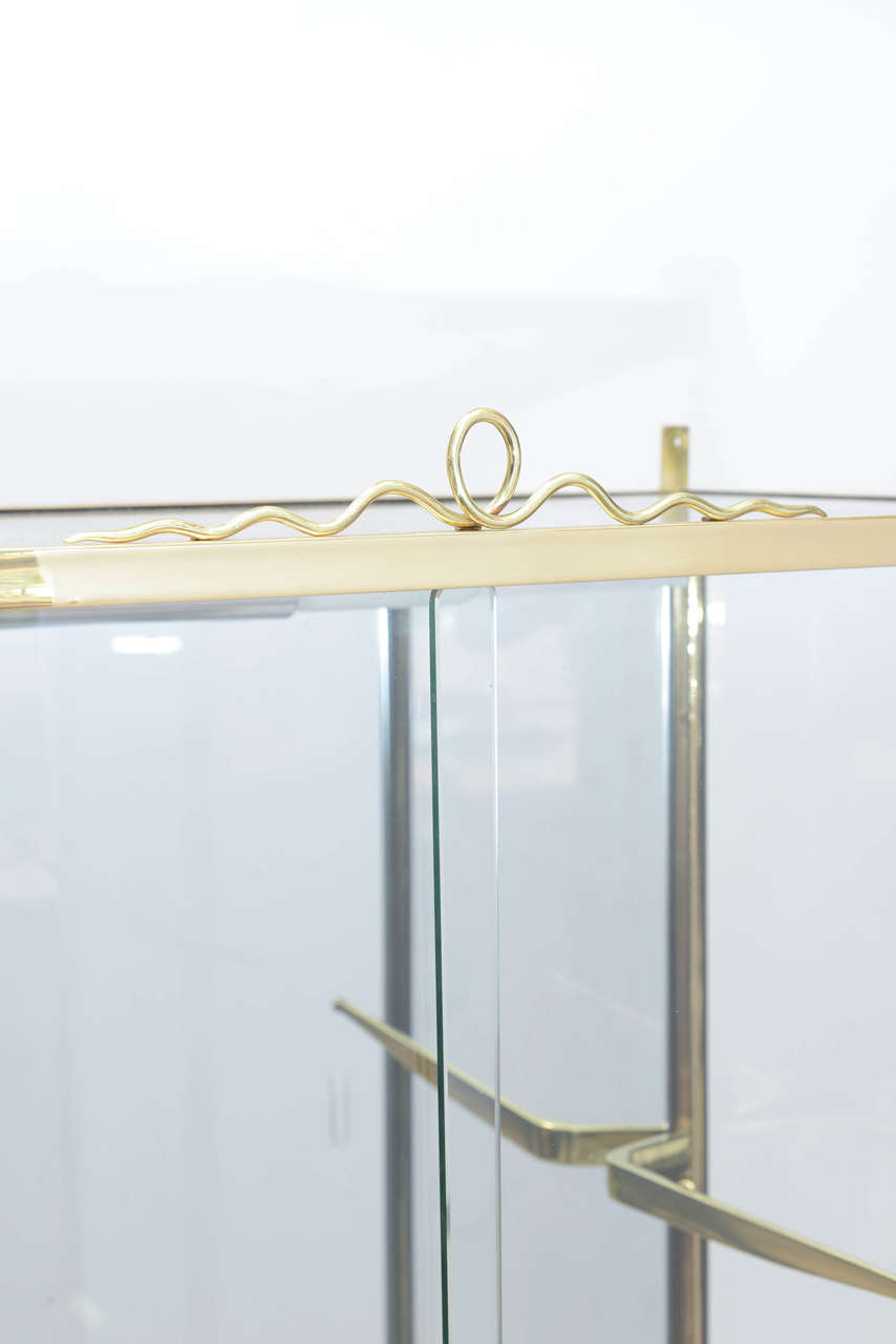 Italian Brass and Glass Vitrine in the Manner of Osvaldo Borsani For Sale