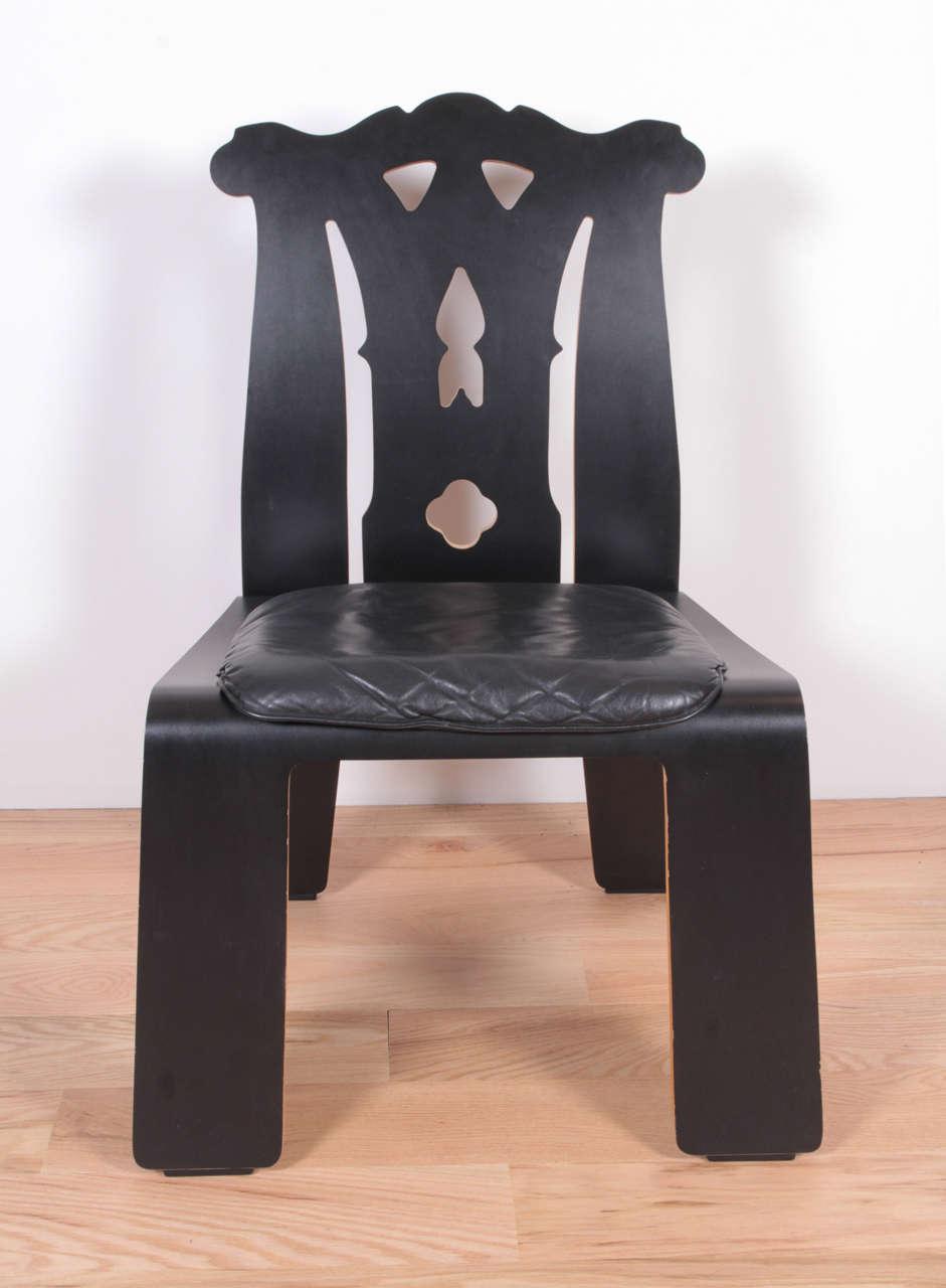Black laminate plywood, black leather seat.   Six available.