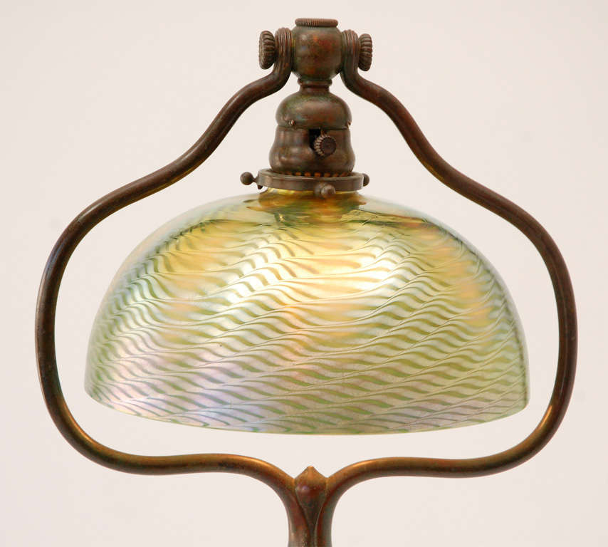 "A stunning patinated bronze floor lamp with damascene glass shade. The base is stamped ""Tiffany Studios NY"" (See Image 10) and the shade, which measures 9.5"" diameter, is signed ""L.C.T."" (See Image 9)"
