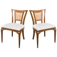 Mid Century Pair of Teak Chairs with Cane Backrests