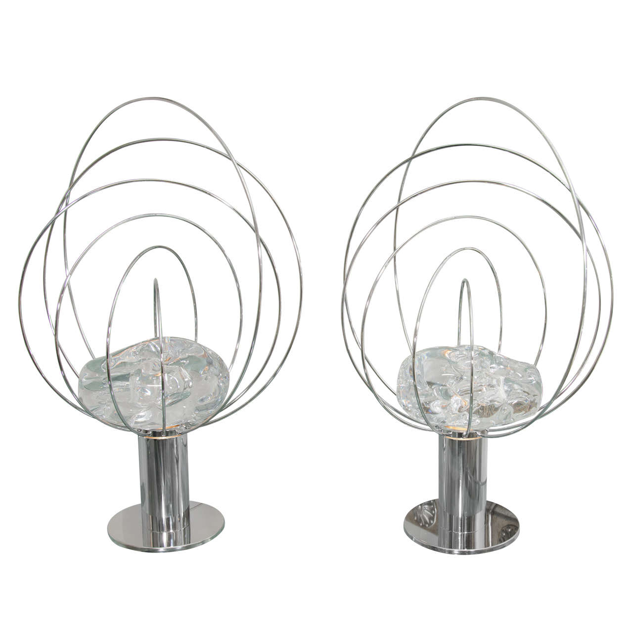 pair of chrome orbital form lamps with rock crystal center