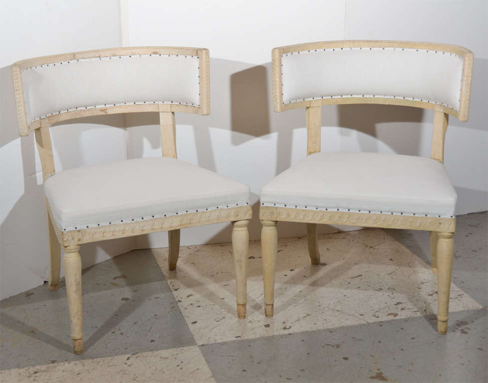 Beautiful pair of Swedish Gustavian Klismos chairs, paint has been completely removed and taken to the natural wood. Front legs are tapered, back sabered legs.