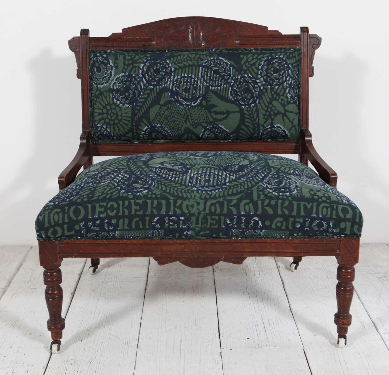Vintage Settee On Casters Upholstered In African Textile.