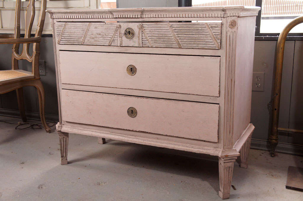 Swedish Gustavian Louis XVI period painted chest of drawers with raised reeded detail , three drawers and dental molding around the top.