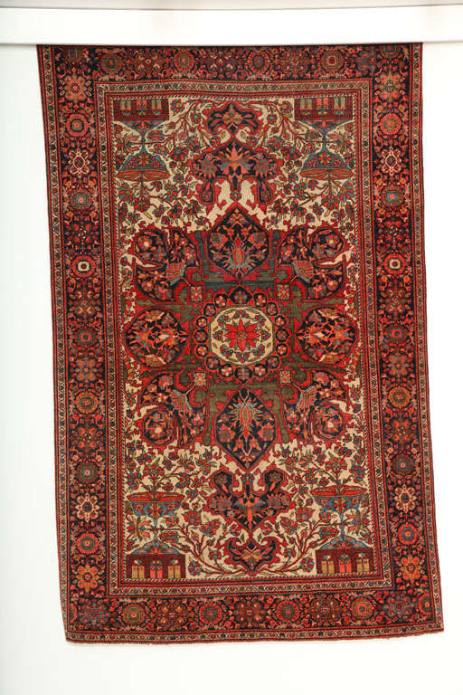 This Persian Fereghan rug consists of a cotton warp and weft and handspun wool pile. Its vivid yet earthy colors are derived from organic vegetable dyes, the reds, greens, blues and cream tones working together to create a unique medallion design