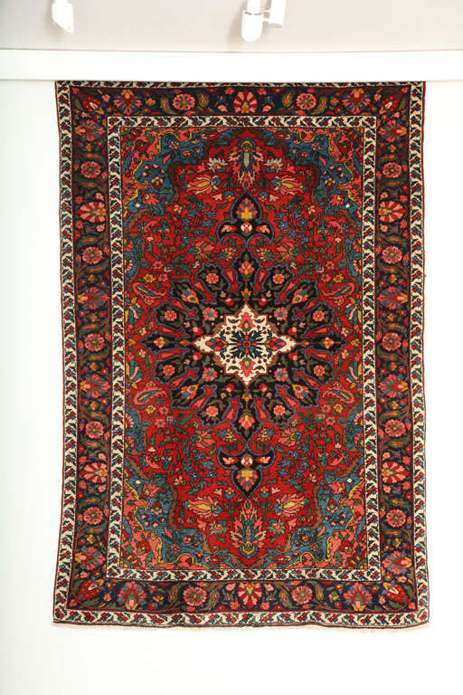 This 1920 Bibibaft Bakhtiari is an improvisational piece of exceptionally fine quality. It consists of a cotton warp, handspun wool weft and hand-knotted handspun wool pile, and its rich blues, reds, pinks and greens were all created using natural