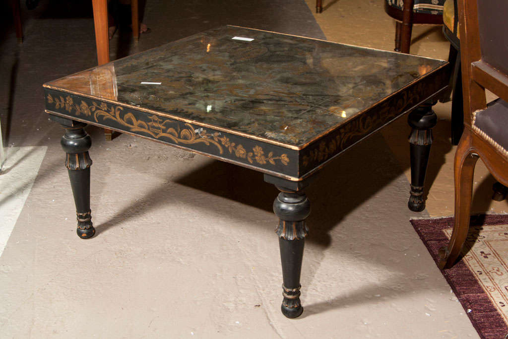 A painted low square coffee or cocktail table, circa 1940s, the top with églomisé glass of chinoiserie scene, over an apron with hand-painted decoration of pagoda and foliate, raised on bulbous legs. Stamped Jansen.