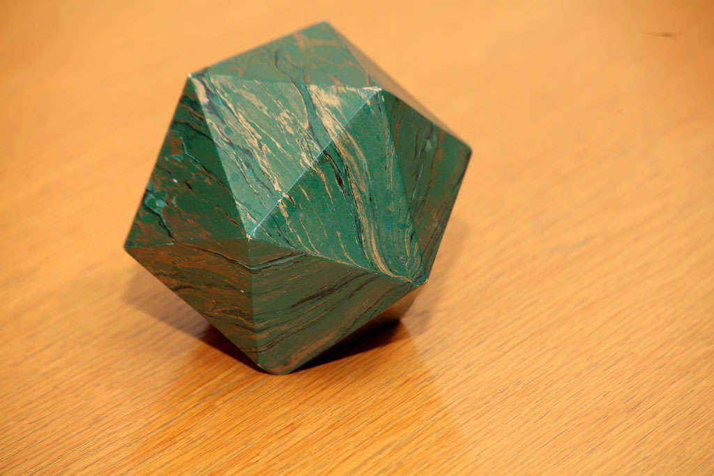This is a beautiful marblized polyhedron weight. Great patina.