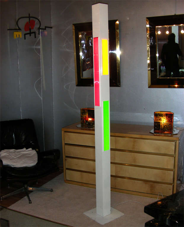 1980s floor lamp in white metal and red, orange, green and blue plexiglass. Signature difficult to read (Joël Donjon ?), numbered 16/250.