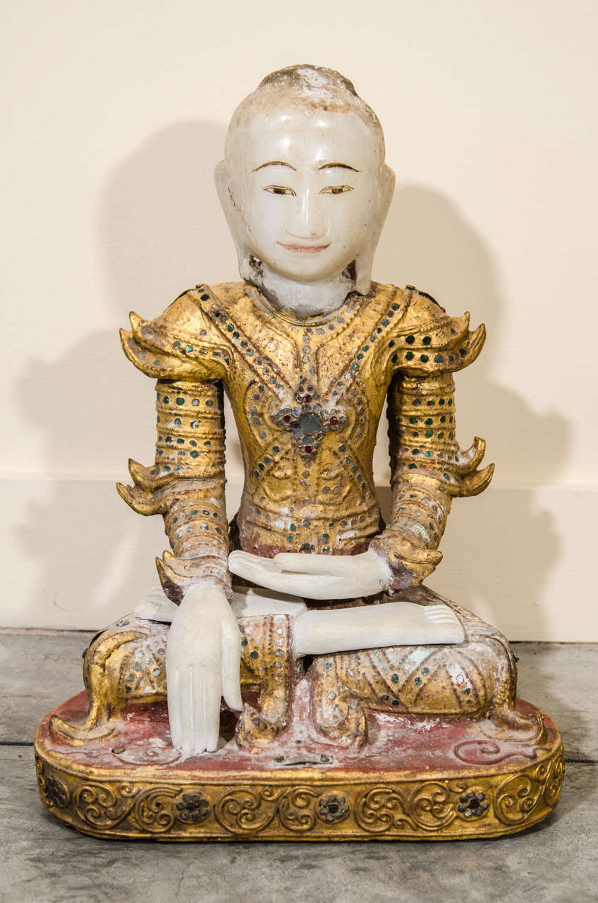 A Mandalay style alabaster and lacquer Buddha dressed in royal costume. Burma, c. 1850.