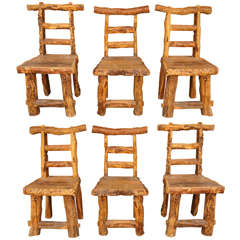A Set of Large Scale Rustic Chairs