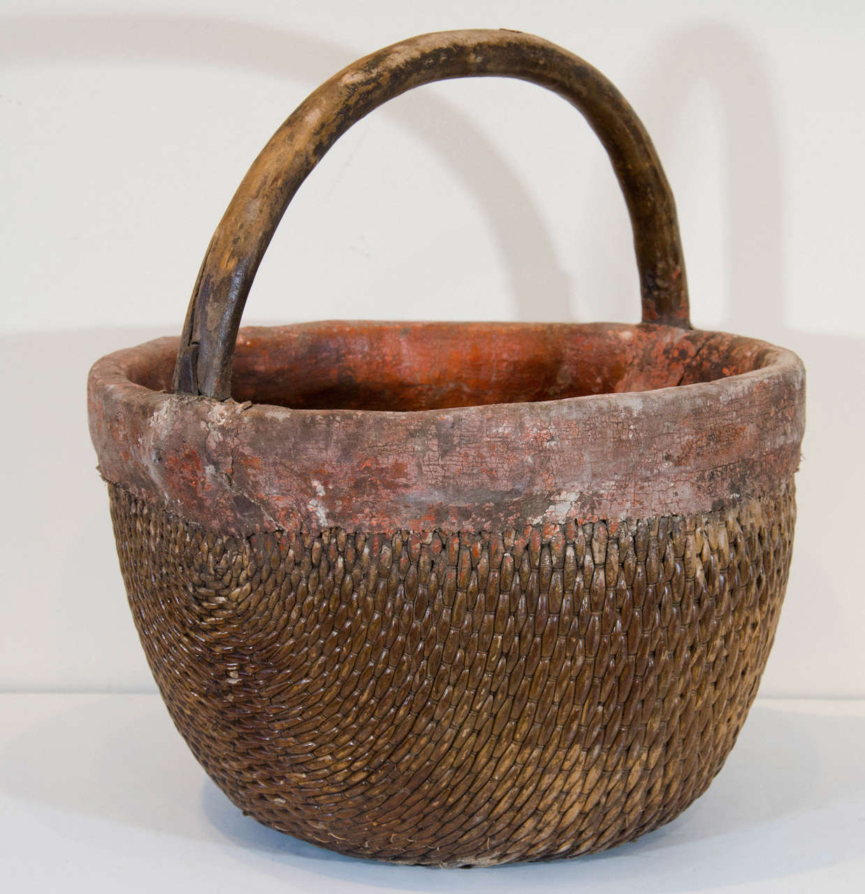 Antique Chinese woven willow basket with clay and/or fabric patches. Wonderfully worn and exhibiting 100 years of use. Only large one available. (Right in main image) B443
