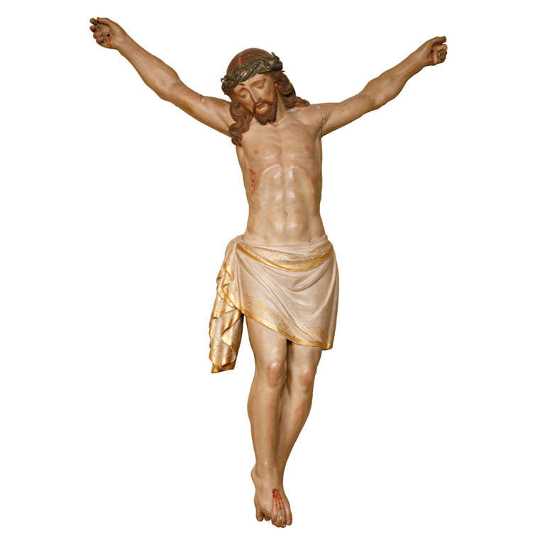 A large 20th century carved and polychrome painted wooden figure of Jesus