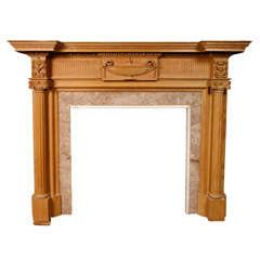 A 19th C. French carved pine fireplace / mantel piece in Neoclassical style