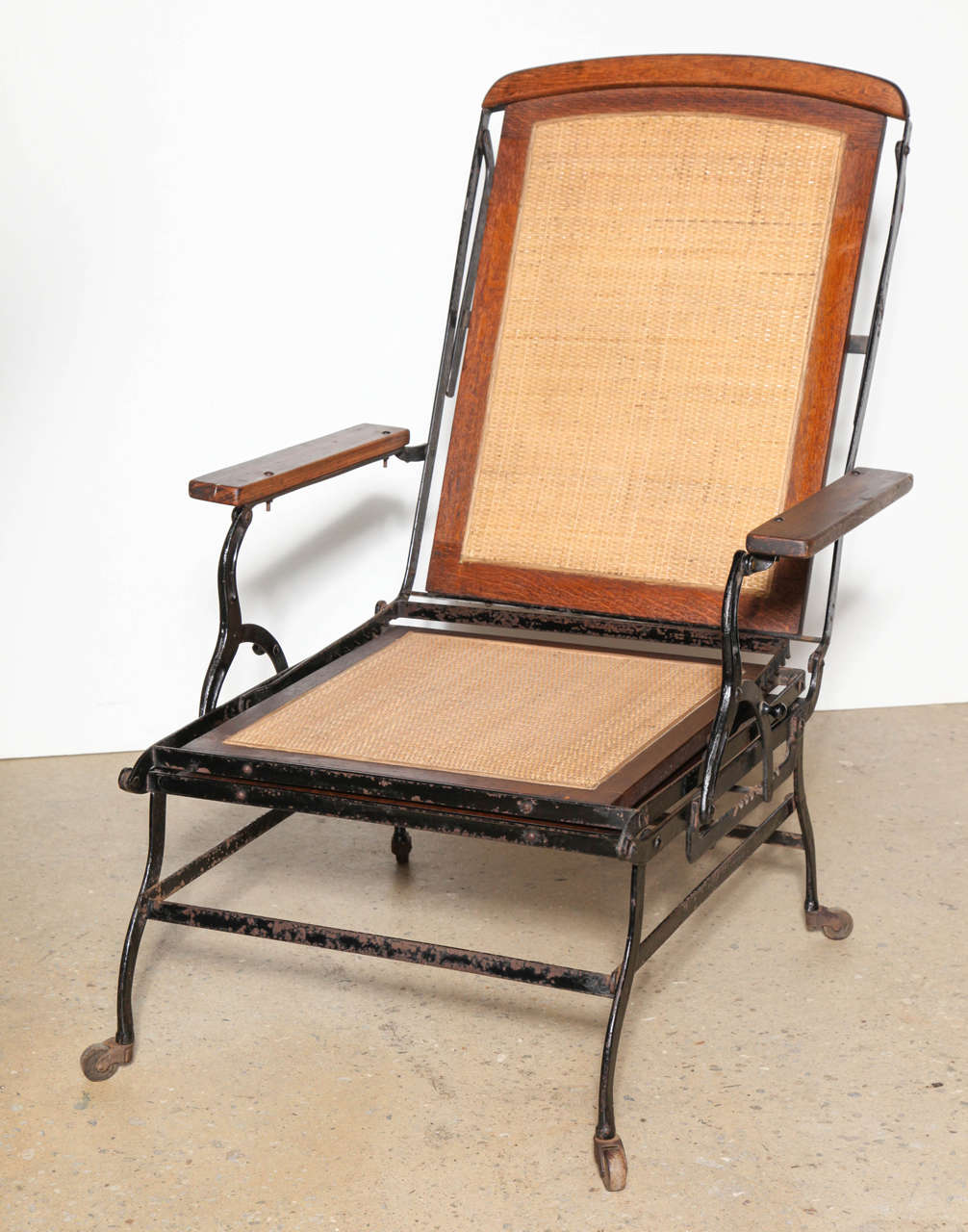Cevedra Sheldon Walnut, Cane & Cast Iron Rolling Chaise Lounge Chair, C. 1876 For Sale 1