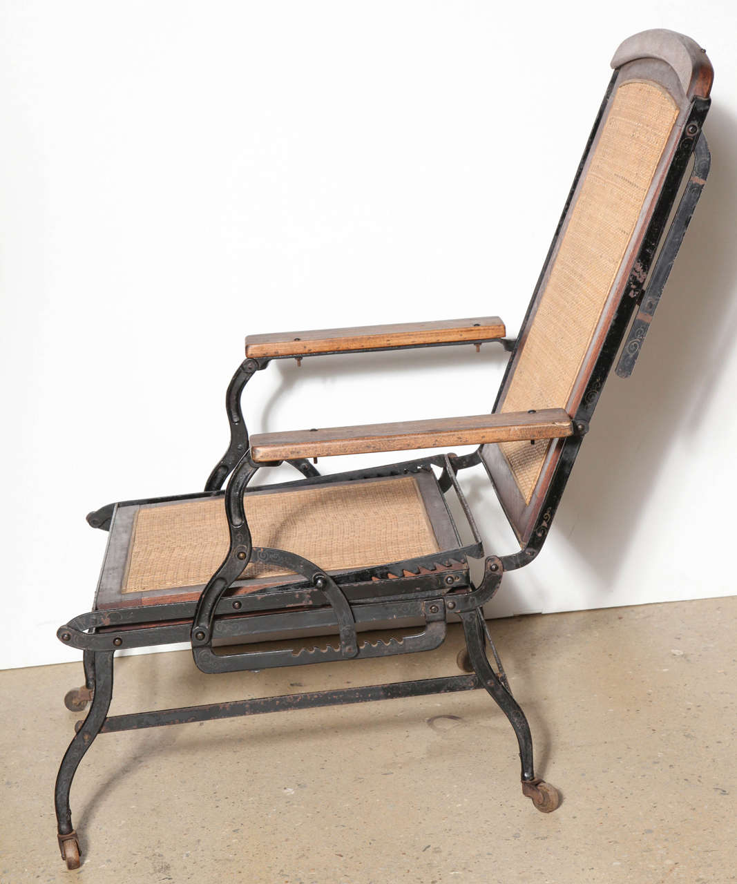 Cevedra Sheldon Walnut, Cane & Cast Iron Rolling Chaise Lounge Chair, C. 1876 For Sale 2