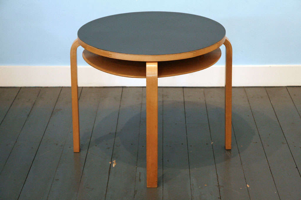 great original sidetable in with black top. with diameter 63 cm. Production 50's (See as well for matching Hallwaychair).