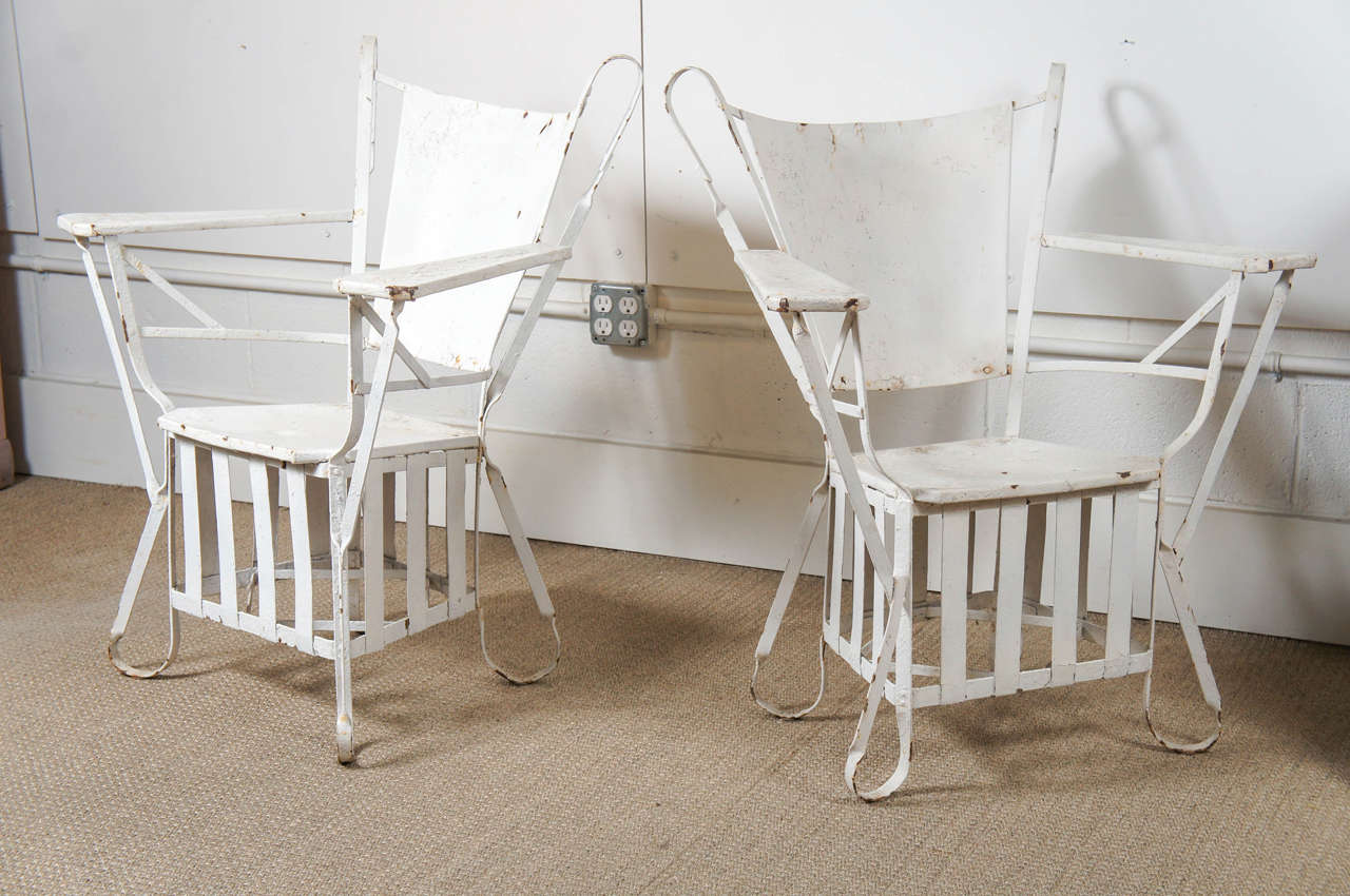 pair of white iron outdoor chairs at 1stdibs