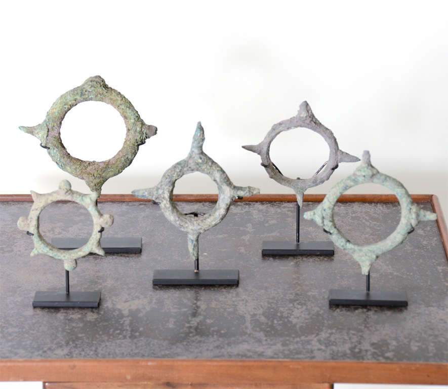 Set of antique bracelets with beautiful patina. Displayed on metal stands.