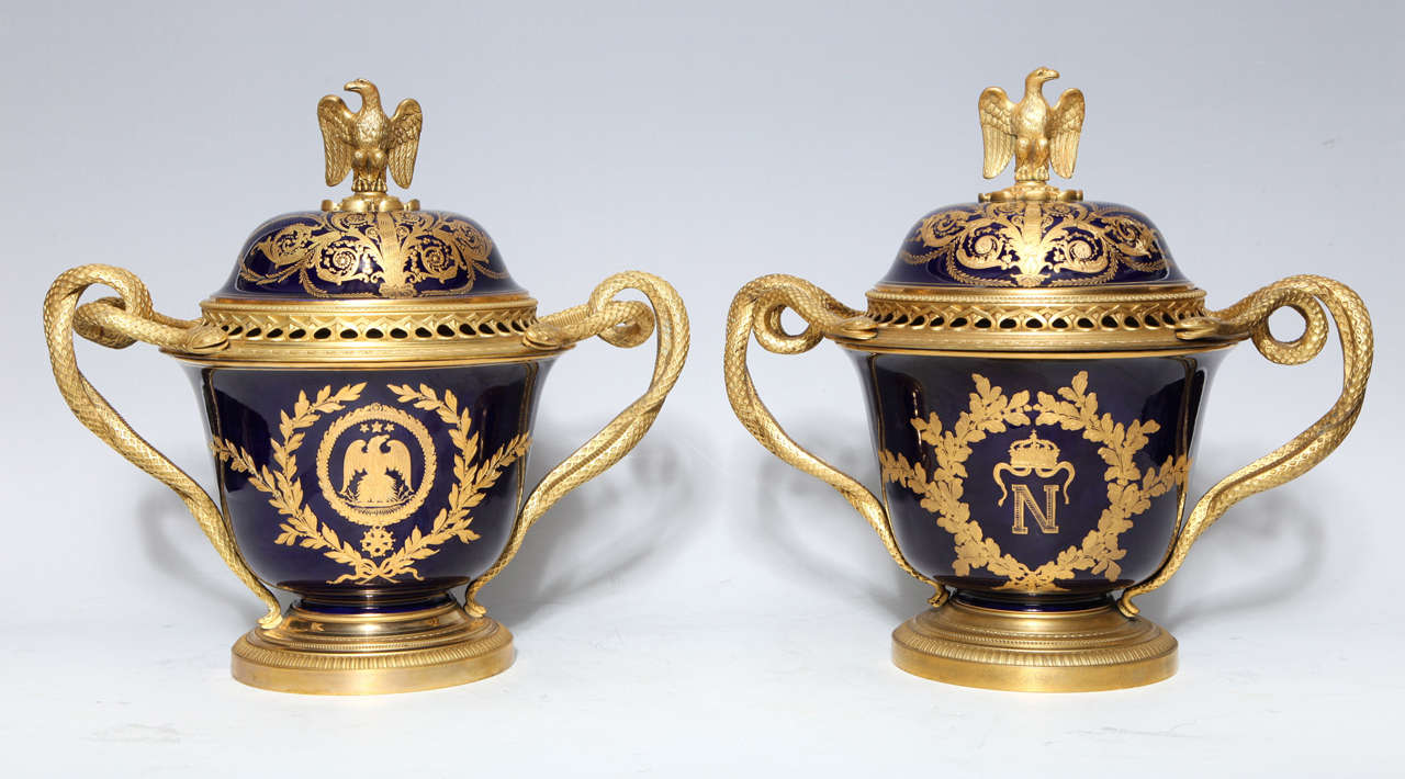 A Pair of Highly Important and Rare Antique French Napoleonic Gilt Bronze Mounted, Cobalt Blue, Double Handled, Royal Napoleonic Severs Style Porcelain Covered Vases/ Pot Pourries of Exquisite Craftsmanship. Embellished with Hand Painted raised Gilt