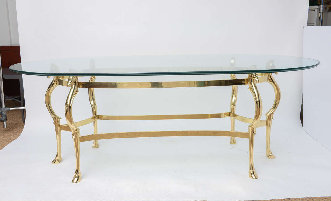 Exquisite Polished Brass Dining Table Featuring Six Legs With Regal Horse  Heads Holding The Glass Top