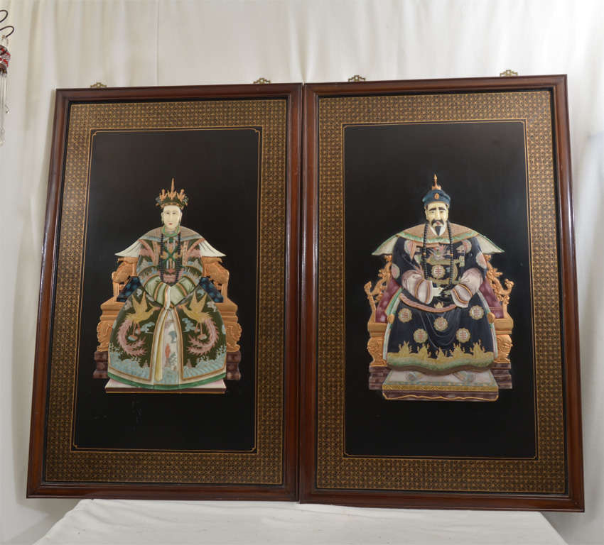 Pair of Framed Chinese Ancestral Portraits, painted on wood and inlaid with carved soapstone simulating precious materials (ivory, jade, rose quartz, etc.)