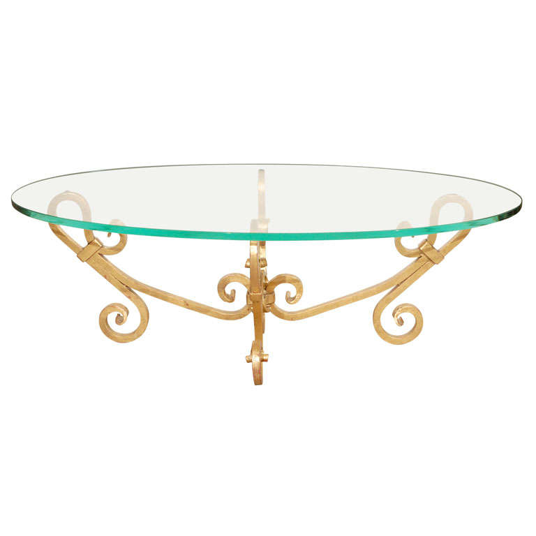 Gilt iron oval glass coffee table venetian style for sale for Designer cocktail tables glass