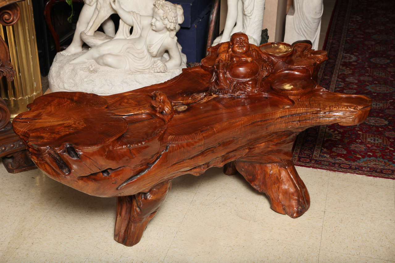 Very unusual carved tree trunk Chinoiseri style coffee table with a carved Buddha