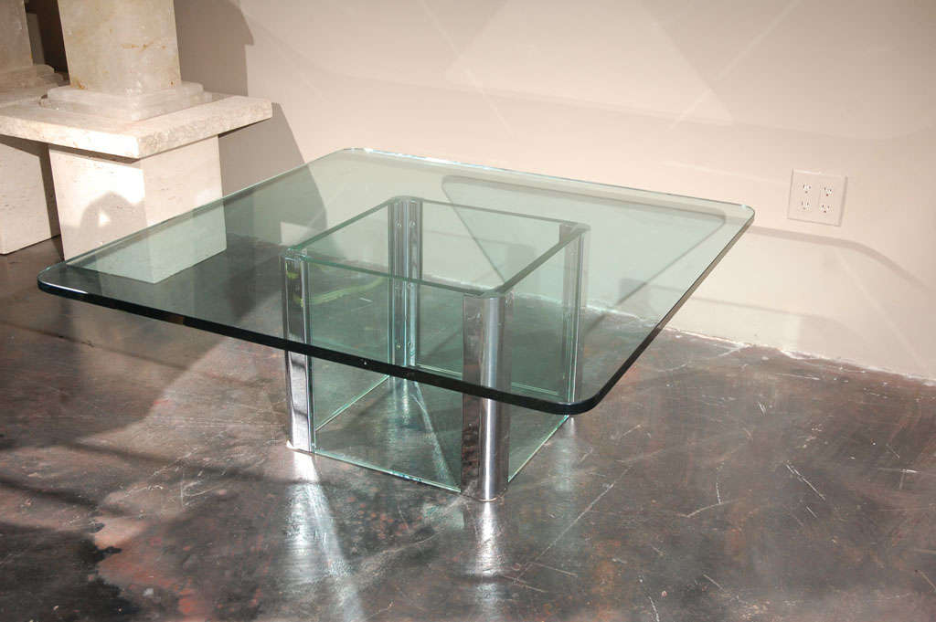 A chrome and glass coffee table by Pace International. Chrome corner mounts holding thick pieces of glass on each side. Base only without glass top measure 17 1/2
