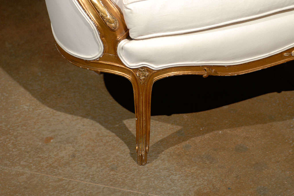 19th Century French, 1860s Louis XV Style Upholstered Giltwood Petite Sofa with Carved Crest For Sale