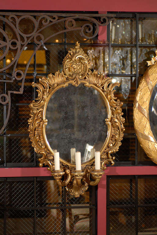 Magnificent pair of gilt wood mirrored sconces with three lights