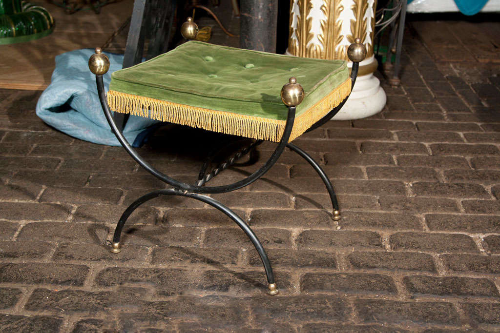French iron bench with brass ball finials and feet.