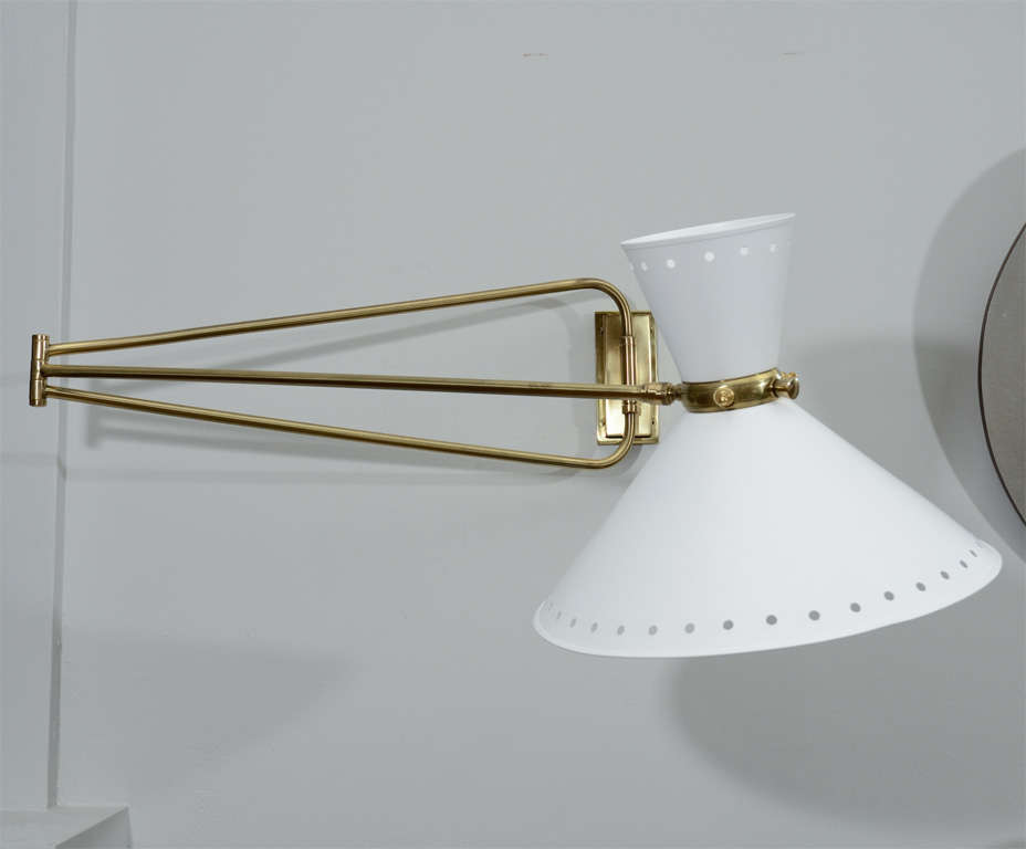 Large pair of lunel swingarm sconces with metal shades. Custom backplates for J-box.