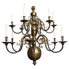 A Twelve-Light Dutch Baroque-style Two-Tiered Bronze Chandelier